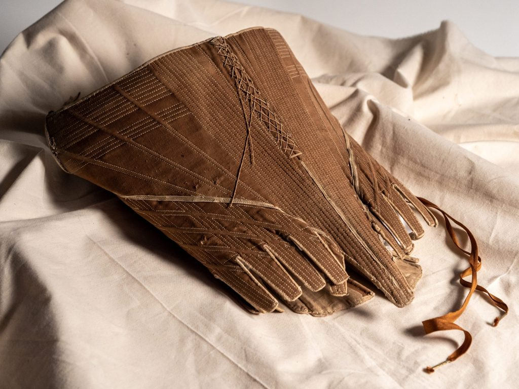 A pair of buff coloured leather gauntlet gloves circa 1650. Museum Ref: 2760/B