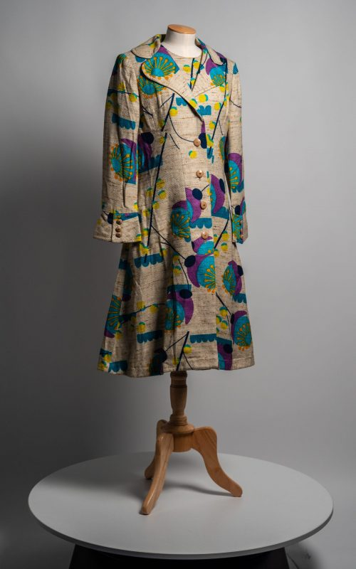 Dress & coat 1969-70. Matching cotton trical, beige fleck with abstract design in green, turquoise, orange, purple. Museum Ref: 1995/401